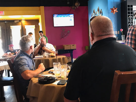 People watching a TV in a restaurant